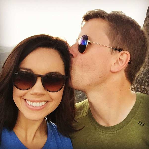 Lovely picture of Scott Conroy kissing his wife Jo Ling Kent