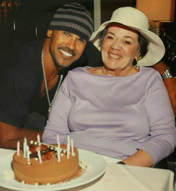 Shemar Moore cutting cake on Mother's Day