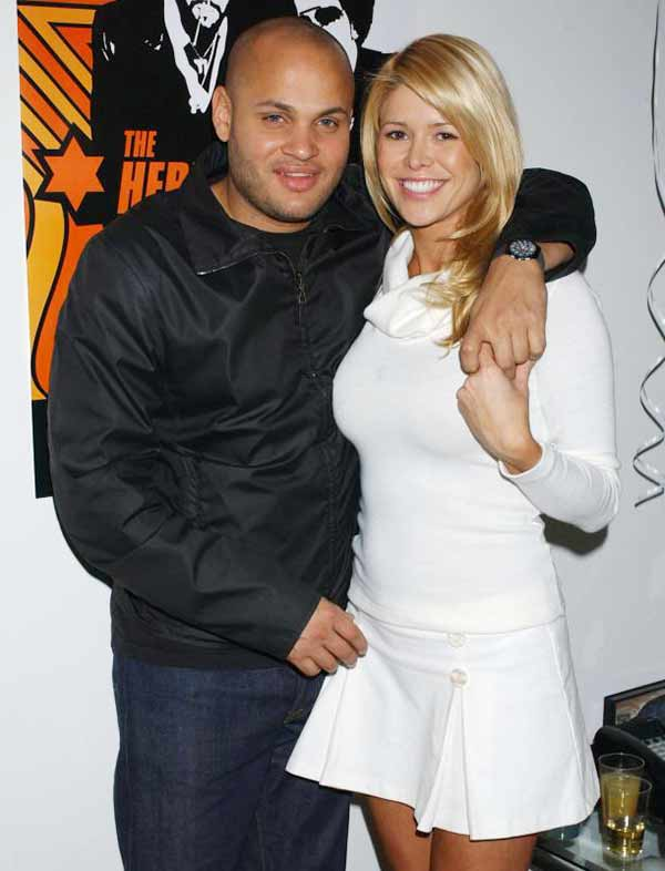 Stephen Belafonte hugging his long time girlfriend Nicole Contreras