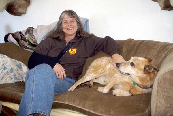 Sue Aikens with her pet in house