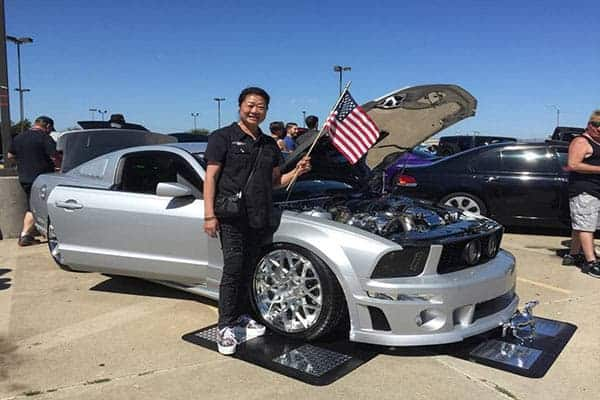 Sue from fast and loud with U.S.A flag In hand