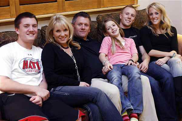 Image of Kyle Whittingham with his wife Jamie Daniels and their kids