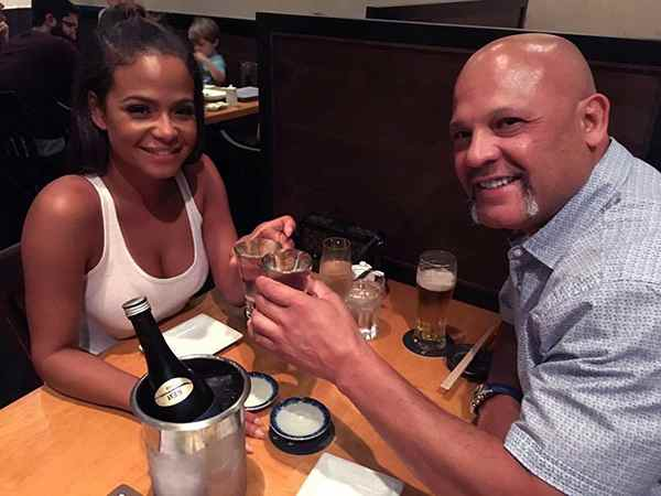 Image of Christina Milian with her father Don Flores