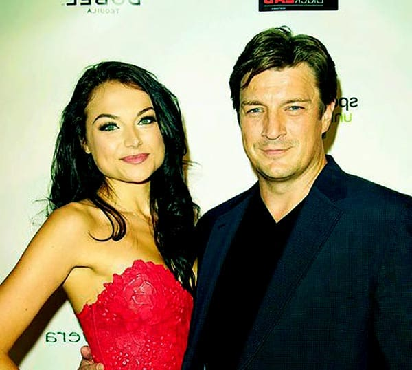 Image of  Christina Ochoa & Nathan Fillion Attending An Award Function