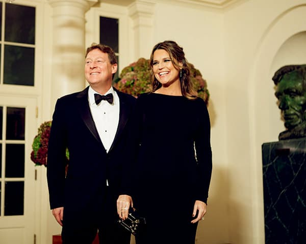 Image of Savannah Guthrie and her husband flaunting a Total Tux and-Long-Black-Gown